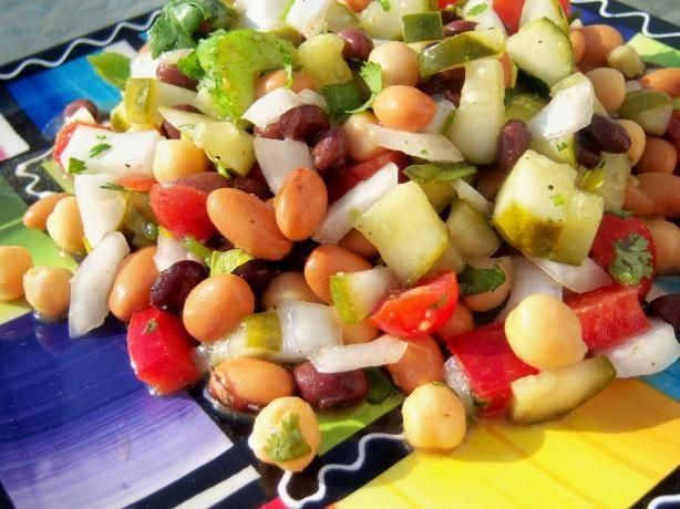 Cuban Bean Salad from Food.com:   Cuban cuisine is a fusion of Spanish, African and Caribbean cuisines and closely resembles that of other Caribbean nations such as Puerto Rico, Dominican Republic, and Panama of Central America. While various parts of the island were influenced by many different immigrants, the Cuban cuisines developed locally, from the influences and demographics specific to each area. Prep time = cook time. Recipe from www.tasteofcuba.com/courtesy of Kraft Foods and ...
