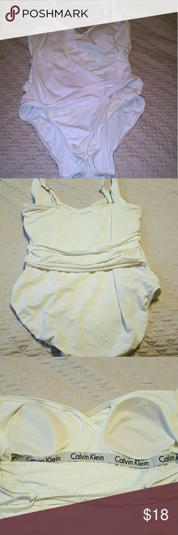 White One Piece Calvin Klein Swimsuit Nice and flattering Calvin Klein one piece white swimsuit. One piece with miracle tummy technology. Not see thru at all. Lost wait and doesn''t fit me. Great condition!! Calvin Klein Swim One Pieces