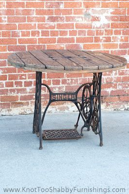 Antique sewing machine base repurposed into outdoor table