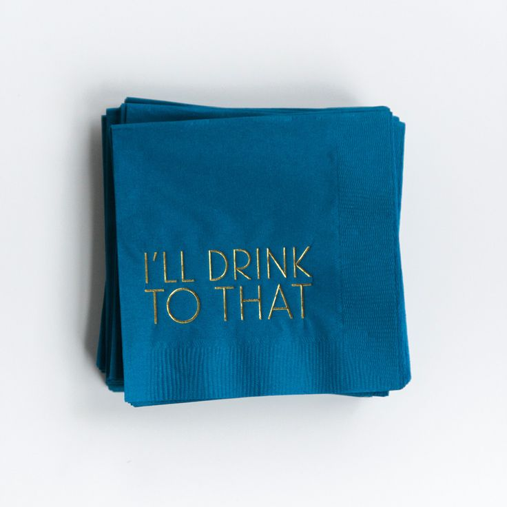 """Complete your bar with a stack of contemporary, cheeky cocktail napkins.   Paper cocktail napkins 4.75"""" x 4.75"""" Navy cocktail napkins with metallic gold foil printing that says """"I'll Drink To That"""" Set of 25 napkins Made in the USA"""