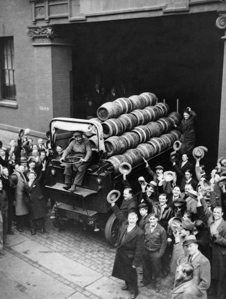 The first truckload of beer to leave New York after the repeal of Prohibition exits the Jacob Ruppert Brewery. Photograph via Corbis.
