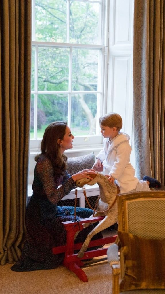 Duchess of Cambrdige Kate Middleton with Prince George at Kensington Palace