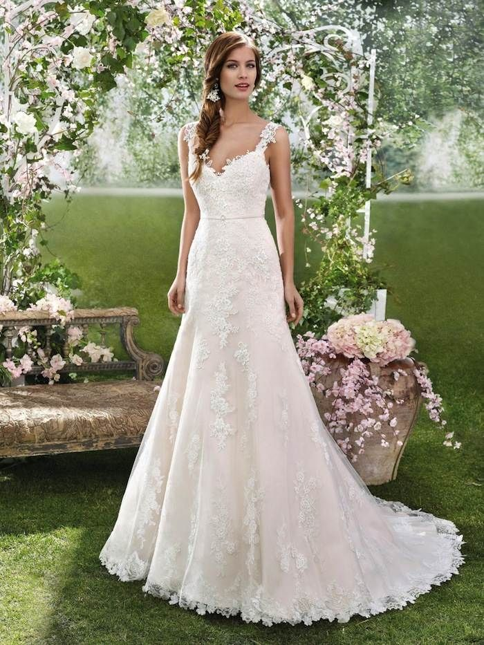 a simple elegant wedding dress in blush with a beautiful lace overlay dress