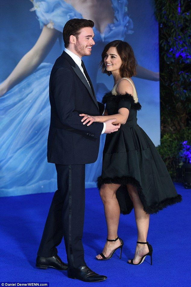 Playful: The pair, who have been romantically linked since 2011, appeared to dance on the red carpet