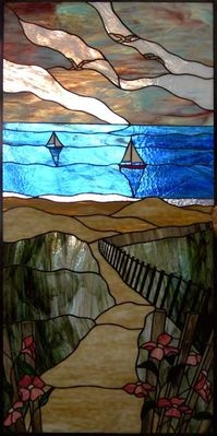 Stained glass sailboats by Phoenix Studio.