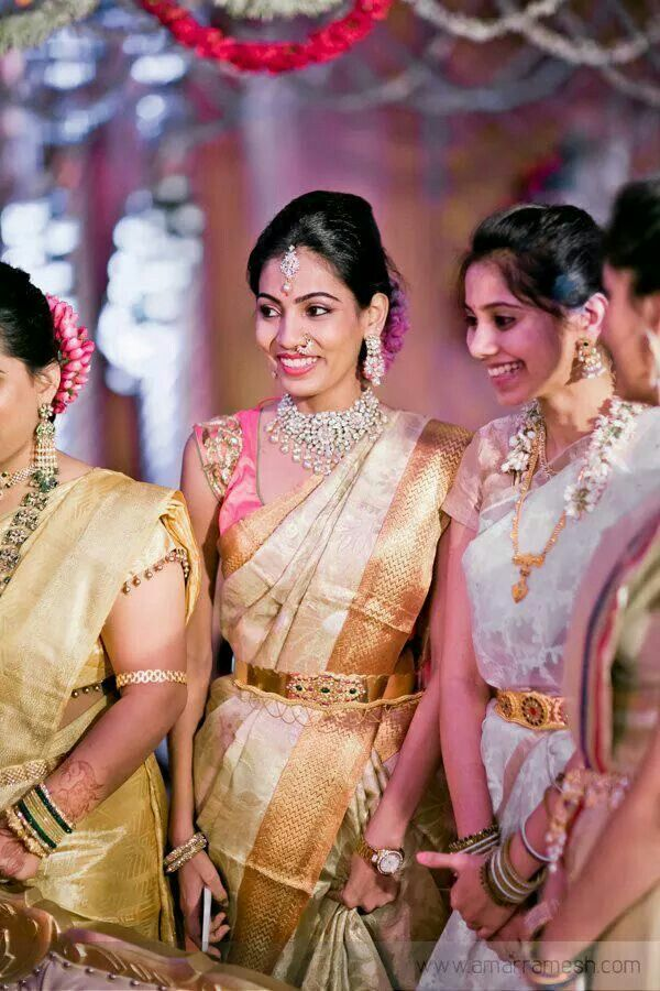 South Indian bride. Temple jewelry. Cream silk kanchipuram sari.Braid with fresh flowers. Tamil bride. Telugu bride. Kannada bride. Hindu bride. Malayalee bride.