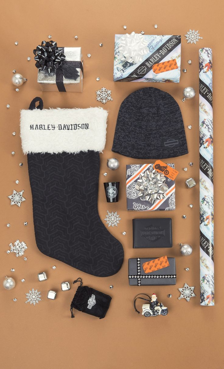 Here is the ultimate Harley-Davidson lover's gift guide! Fill the stocking with things like, this Knit Hat (which comes with a scarf), the Bar and Shield Flip Fold Wallet, and this set of Logo Whiskey Stones. Wrap it all up in Biker Santa Gift Wrap.