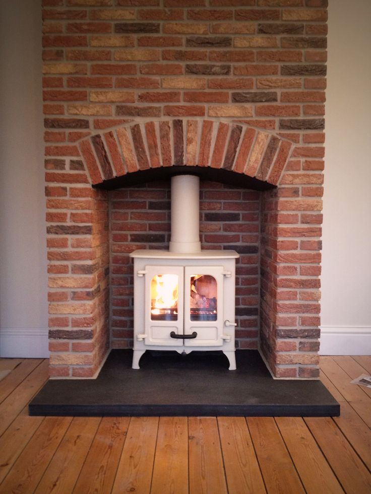 Brick fireplace surround woodburner google search Fireplace setting ideas