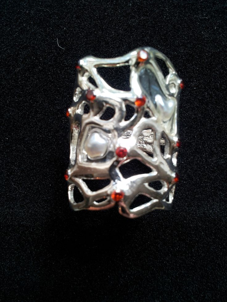Alice in Wonderland; artclay silver with pearl pieces and red zirkons