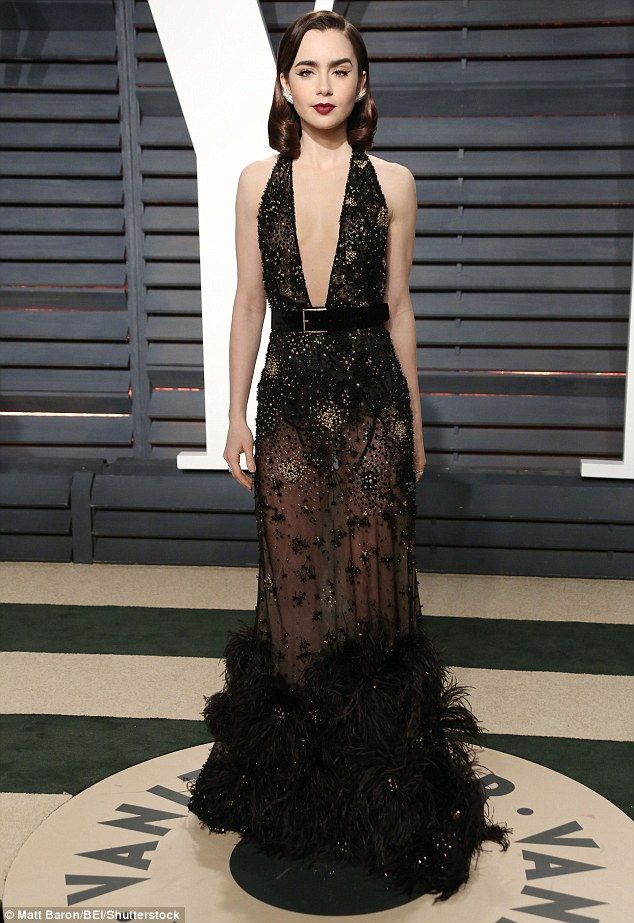 Glamorous: Lily Collins  hit the red carpet at the 2017 Vanity Fair Oscar Party  at Wallis Annenberg Center for the Performing Arts in Beverly Hills, California, on Sunday night