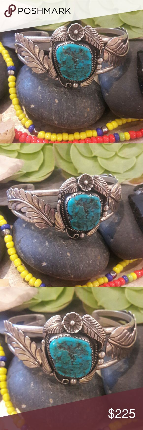 """Vintage Sterling Navajo Signed Turquoise Cuff Beautiful detailed cuff, with a large Turquoise nugget stone, this bracelet is signed by the artist looks to be Ashley, beautiful feathers along the stone and a squash blossom flower on the bottom or top of Turquoise depending on how you wear it, with feather design, and rain drops. Cuff is 1 1/4"""" opening, inside circumference is approximately 6"""" bezel set stone, simply beautiful!! Vintage Jewelry Bracelets"""