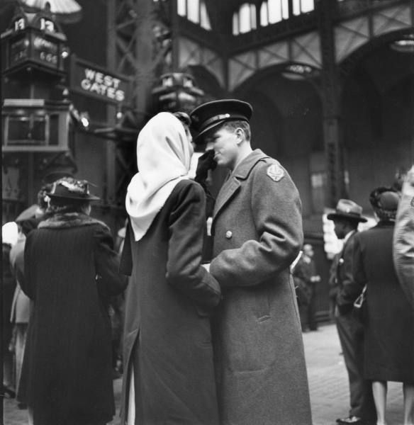 Couple in Penn Station sharing farewell embrace before he ships off to war during WWII.   Photographer: Alfred Eisenstaedt   Date taken: 1943   Location: New York, NY, US   LIFE Archive - Hosted by Google