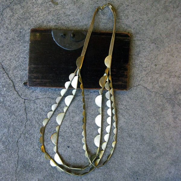 http://shop.tasknewyork.com/product/half-moon-necklace      half moon necklace - brass