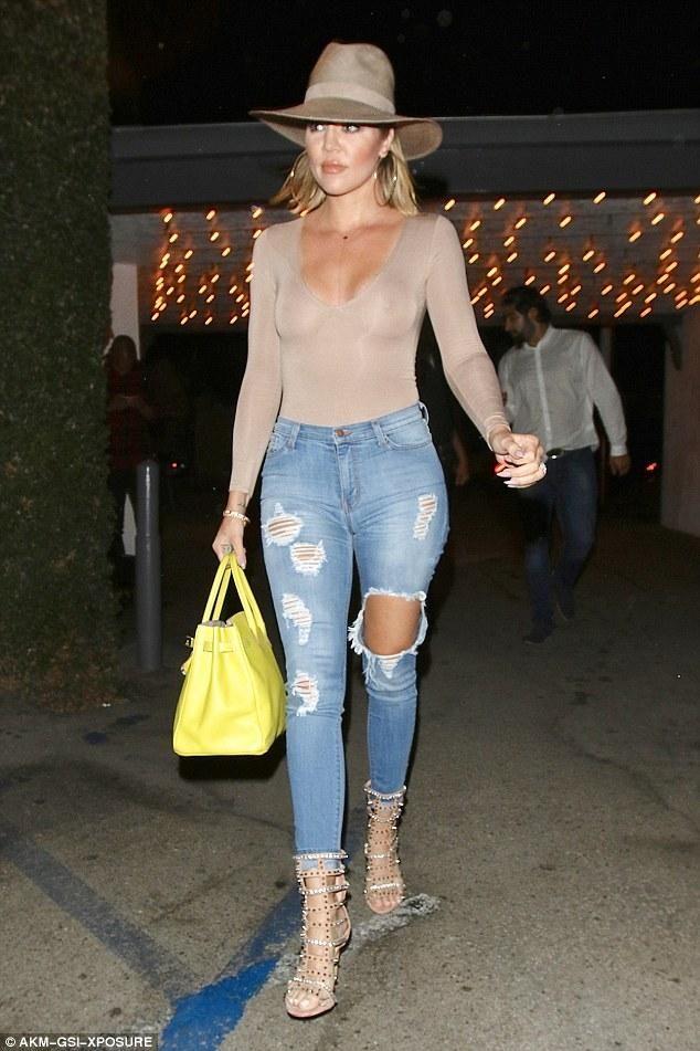 Khloe Kardashian wearing Hermes 35cm Candy Birkin Bag in Lime, Naked Wardrobe Nw Deep V Bodysuit in Taupe and Jennifer Le Razor Spike Caged Sandals