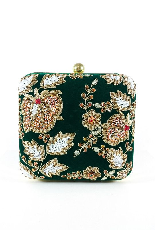 Zardozi and Dabka Exquisite Fabled Craft clutch, perfect for any occasion. A colored metal frame surrounds the bag and is finished with a clasp lock. The interior is lined in colored cotton to complem