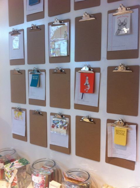 clipboards; did this on a smaller scale.  One for each family member to display one thing of their choice.  The kids love having their own display.
