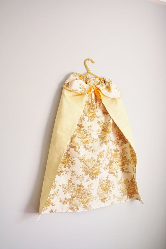 The perfect dress up cape for your little princess, yellow fabric on the outside and fully lined with vintage yellow rose cotton and tying