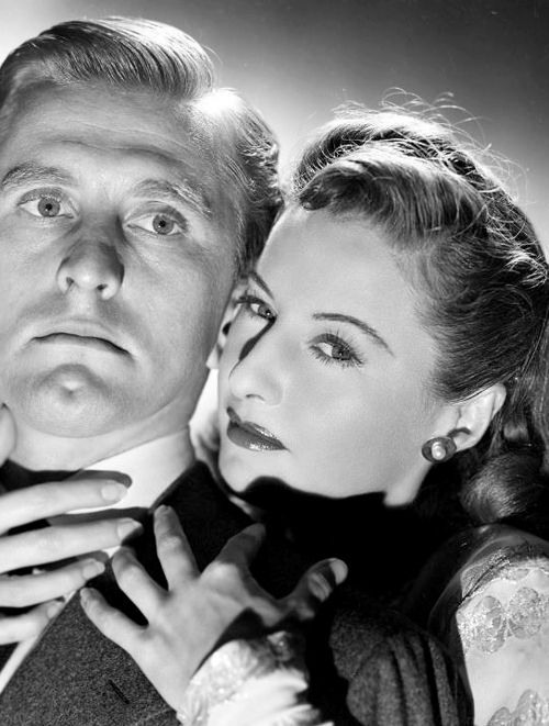 "Barbara Stanwyck and Kirk Douglas in a publicity still for ""The Strange Love of Martha Ivers"", 1946."