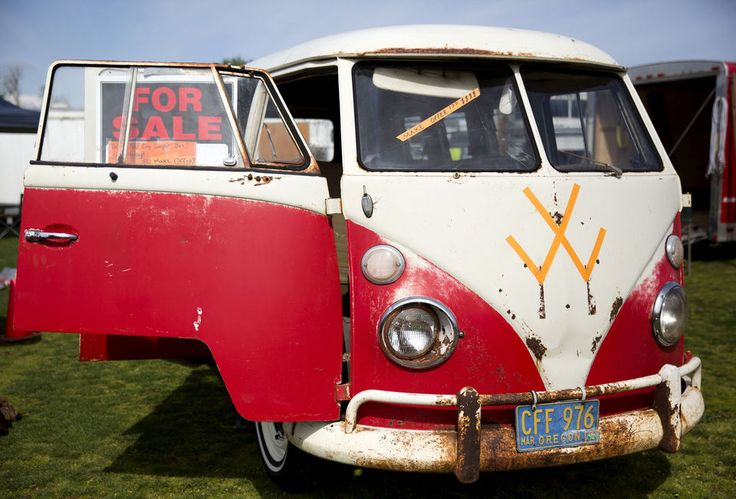 A 1966 Volkswagen Bus with an improvised hood ornaments