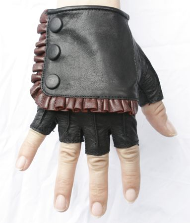 Details  Steam Trunk Spat Glove are made from leather with a front flap with snap closure. (black/maroon) $130. from Five and Diamond