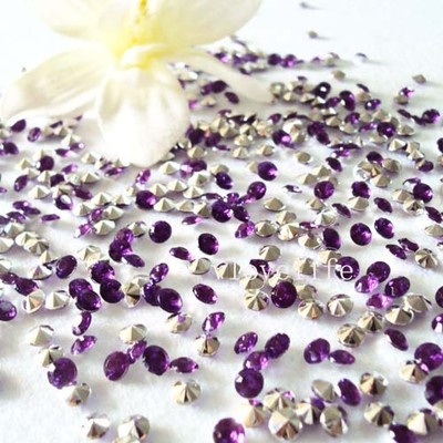 Purple and silver rhinestones for the tables