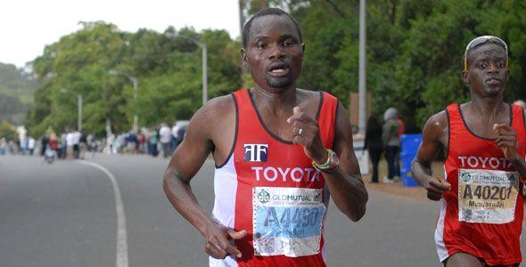 Stephen Muzhingi and Munyaradzi Jari (both of ZImbabwe running under management of Craig Fry) in ToyotaSA Athletics Club Colours, at Two Oceans 2013 - Muzhingi Partners with Fedgroup