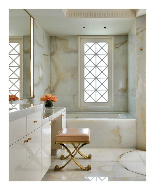 Onyx-clad white bath designed by Greg Stewart. Photo by Nathan Kirkman. From Interiors Digital.