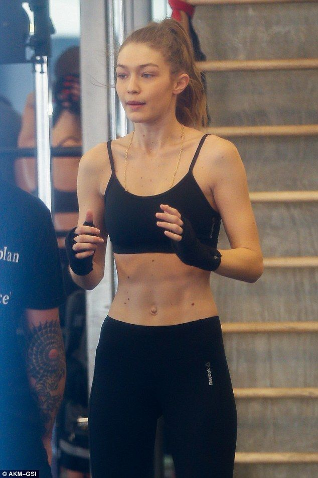All muscle: The 21-year-old model looked amazing in a black crop top and leggings