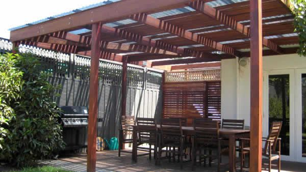 Pergola structure incorporating spotted gum rafters, slats and laminated merbau posts.