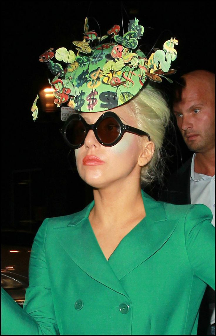 Lady Gaga wearing Philip Treacy's money hat and sunglasses from General Eyewear's 790-995 series. (London,  6th October 2011)