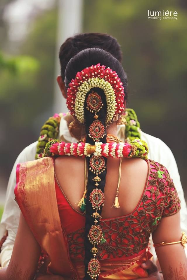 South Indian bride. Gold Indian bridal jewelry.Temple jewelry. Jhumkis. Red and gold silk kanchipuram sari.braid with fresh jasmine flowers. Tamil bride. Telugu bride. Kannada bride. Hindu bride. Malayalee bride.Kerala bride.South Indian wedding.