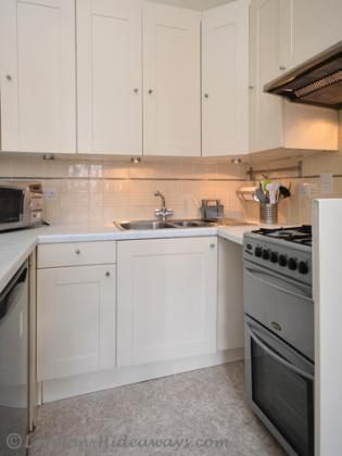 Kitchen facilities - Fridge, Microwave Oven Gas burners, Percolator ,Kettle ,Hob ,fan Toaster, Dinnerware and cookware provided