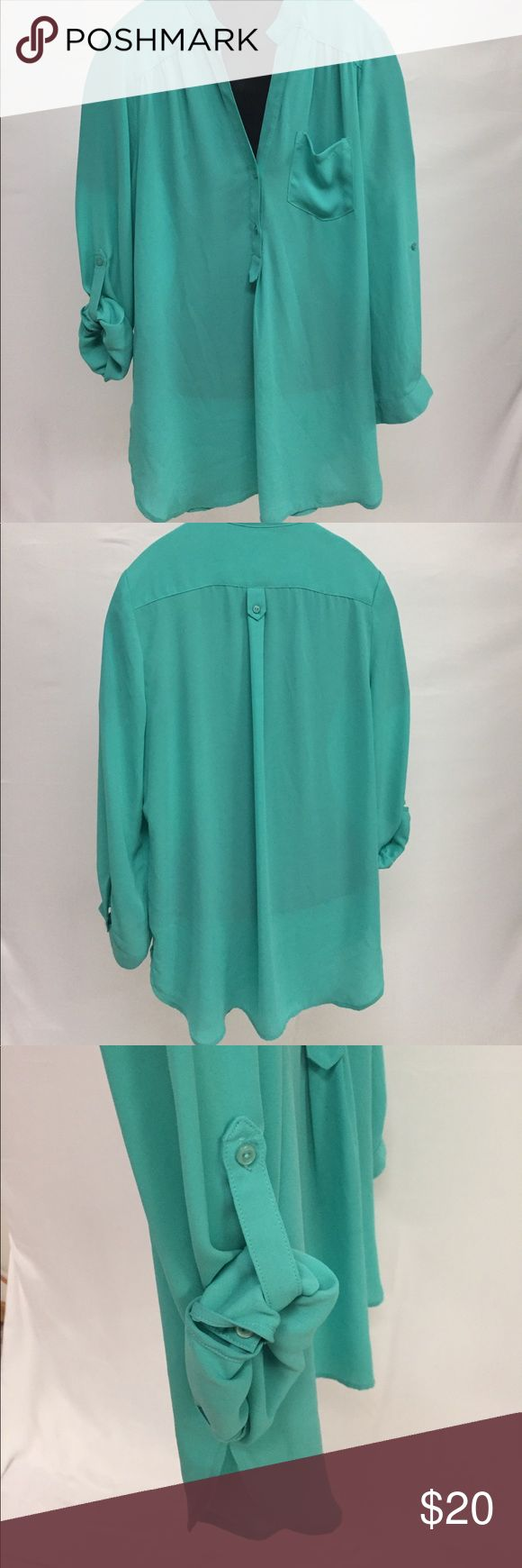41 Hawthorn Green Tunic Top PERFECT FOR SPRING This is a beautiful 100% polyester 41 Hawthorne green Tunic. This shirt is thinner material so it's perfect for spring. Great worn with leggings or skinny jeans. There is one very minor spot that is captured on the last pic of the tag. It is not very noticeable and I only found it while doing a very deep inspection of the shirt. Great shirt for work or casual! 41 Hawthorn Tops Tunics