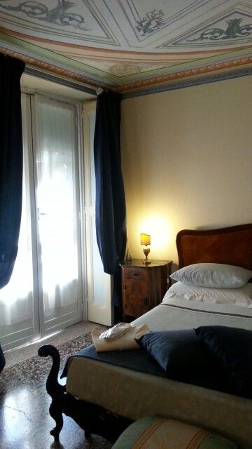 One grandma's bed, frescoes on the ceiling and a special atmosphere that makes you relax and feel at home in one of our special accommodations in #genoa www.beautifuliguria.com