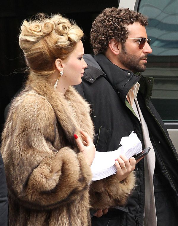 #JLaw and Bradley Cooper on the set of 'American Hustle'