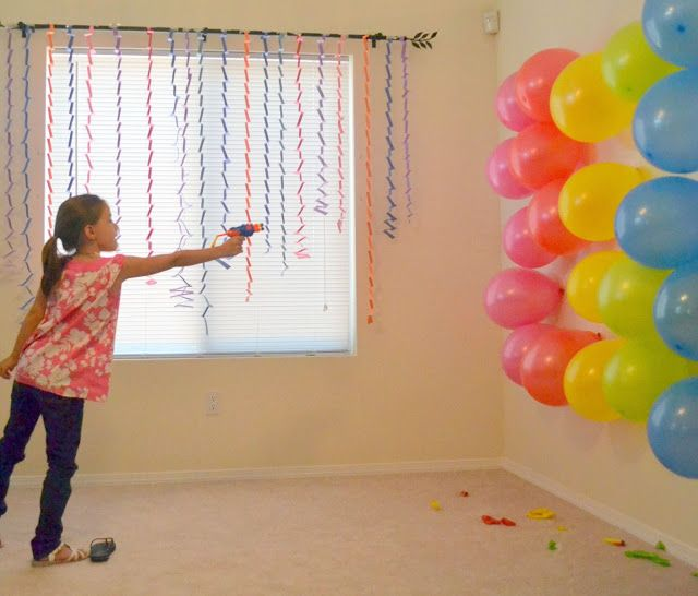 how to make a balloon gun that shoots