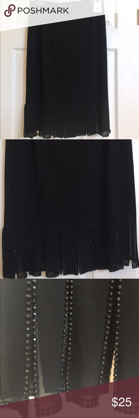 Black skirt by MSK. Size small. NWT. Black holiday skirt with fringed bottom with sparkling accents, by MSK. Size small. Skirt is 26 inches long.  NWT MSK Skirts