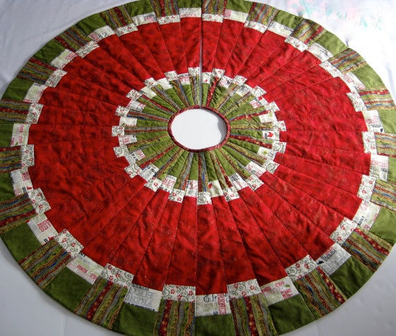 Swapped out the colors on this one. Just love the gold flecks on the red. Christmas Tree Skirt Patchwork Quilted by SallyManke on Etsy