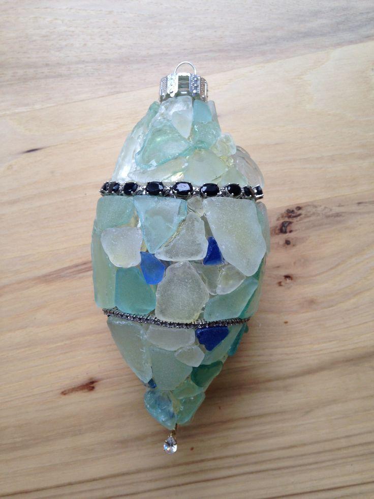 Saphire and diamond bracelets adorn this beach glass ornament.