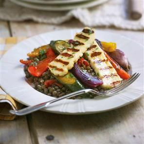 Puy lentils with roasted vegetables and griddled halloumi recipe. This Mediterranean inspired vegetarian dish is great for using up leftover vegetables in the fridge. The haloumi cheese lends an interesting texture.