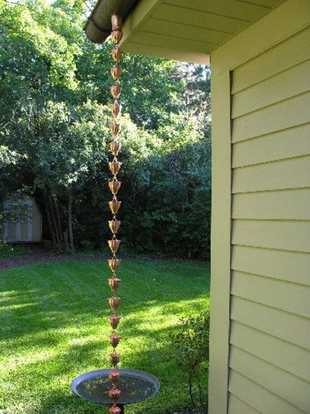 Rain chain: an alternative to downspouts.     Rain chain with fluted cups. $119.25 at guttersupply.com