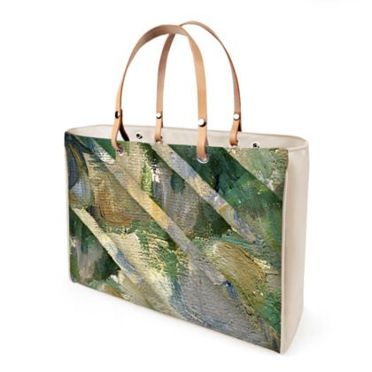 """""""Cézanne/Dettagli""""  Available in leather or vinyl finishes Leather handles and steel protection feet Two inner pockets, one with zip 2 sizes available: small and large 10 years warranty"""