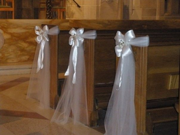 Bows---Always a classic aisle choice.  Maybe alternate white bows with wedding color palate to mix it up.