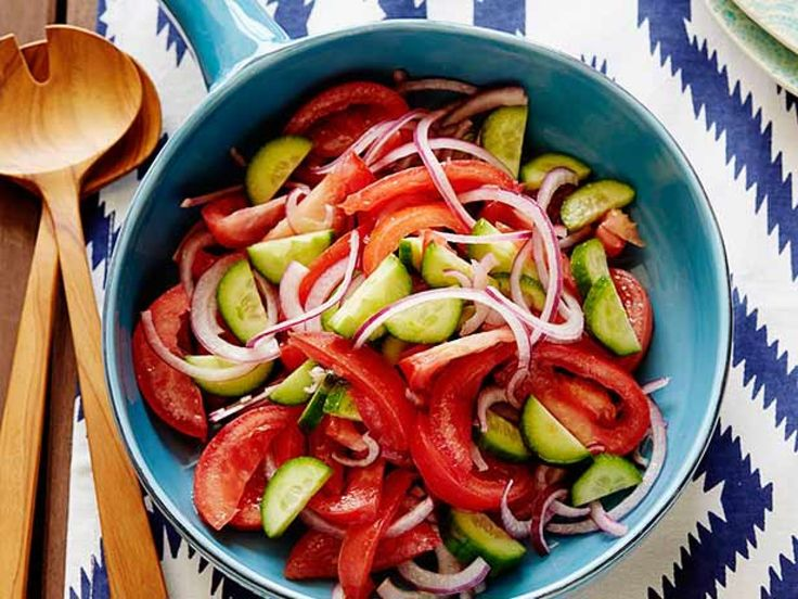 Tomato, Onion and Cucumber Salad : Rachael Ray uses Kirby cucumbers for this salad because they have a very thin skin; you can just wash them and use them without peeling.
