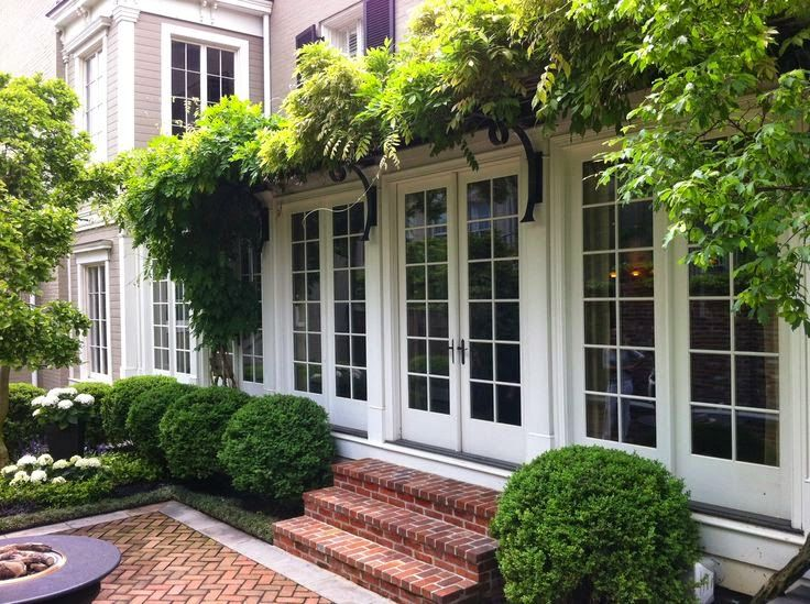 Lucy Williams | lovely outdoor space | French doors | hanging plants | boxwood bushes