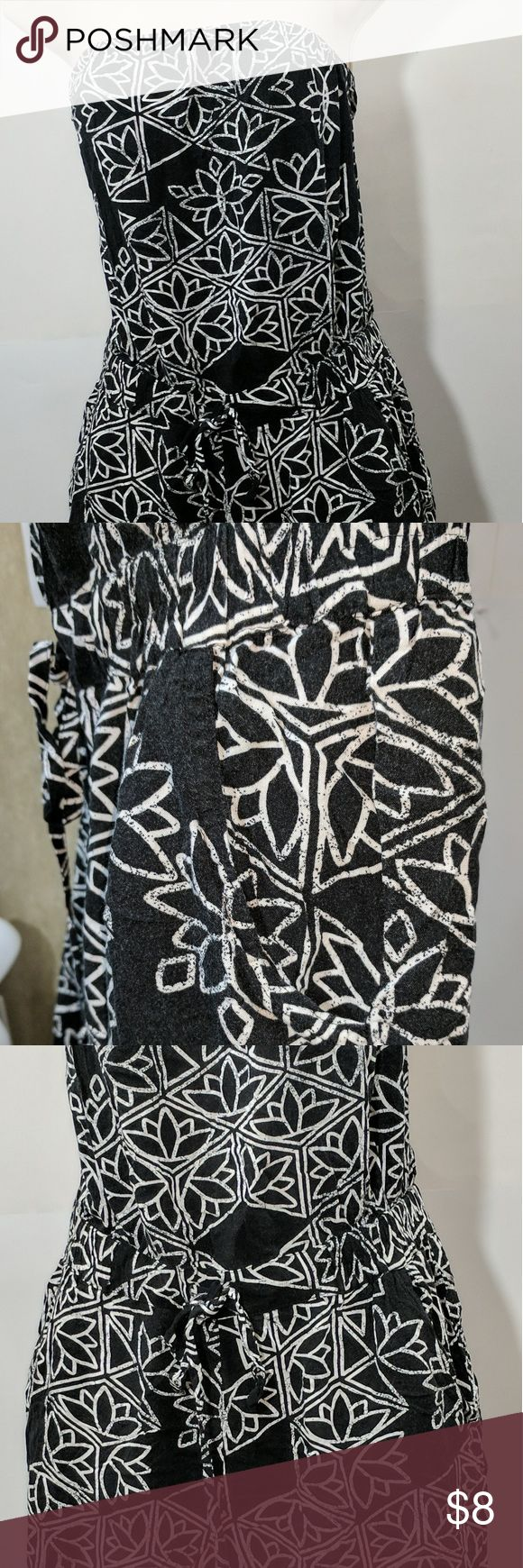 Ladies halter romper Capri leg size L This is a ladies romper halter top pant Capri Style black and white print with pockets and string tie at waist. When white flat from bottom of leg to top of halter is approximately 43 in. From bottom of leg to crotch is approximately 21in from armpit to armpit is approximately 15 in. And good conditions no signs of lawyer Mudd Pants Jumpsuits & Rompers