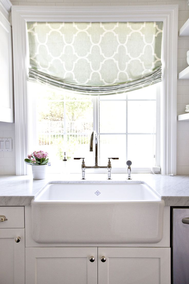 White farmhouse sink & marble counters in the kitchen :) change the handles though!
