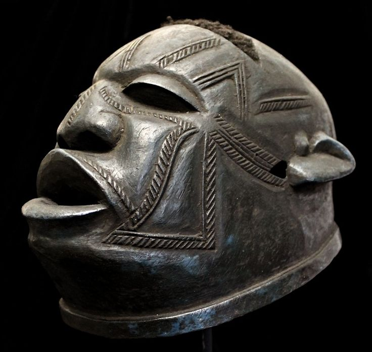 old Lipico mask from the Makonde peoples of Tanzania. Worn on top of the head, the ceremonial Lipico masks are primarily danced during circumcision rituals for boys.  Characterized by strong, human facial features, superb raised & incised scarification patterns accentuate the cheeks, brow, under the eyes, across the upper lip, & along the bridge of the broad nose. Much of the mask's (human) hair is still intact.