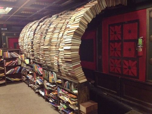 Book Tunnel at The Last Bookstore, LA has a book tunnel, a wave sculpture of books, tall pillars and even a  'wooly mammoth' head!