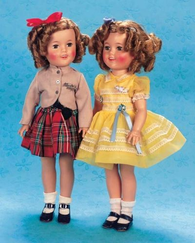 """""""Shirley Temple"""" by Ideal in Plaid Skirt  17""""(43 cm.) All-vinyl doll with socket head,brown sleep eyes,lashes,painted lashes and brows,slightly-parted lips,row of teeth,rosy cheeks,five-piece body. She is wearing her original tagged costume comprising plaid taffeta skirt with attached petticoat,matching panties,twill uniform jacket with Shirley Temple pin,shoes and socks. Excellent condition with bright rosy cheeks and crisp costume. Ideal,circa 1959.  -- """"Shirley Temple"""" by Ideal in…"""